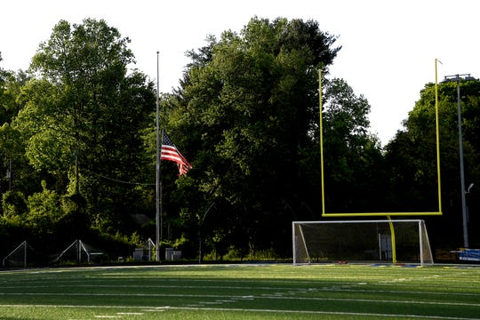 An American flag at Roberson High School flies at half-staff  for UNC Charlotte shooting victim Riley Howell before the start of a Roberson girls home soccer game on May 1, 2019. Howell was a graduate of Roberson High School and a member of the soccer team. Police say that Howell's actions taken during the shooting saved lives.