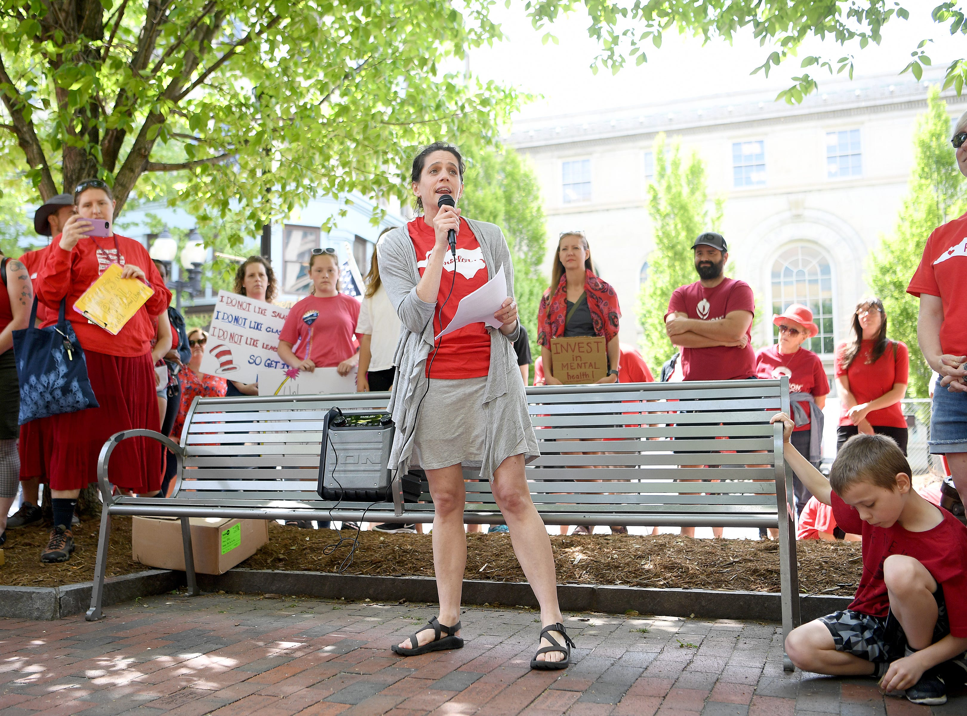 Kristin Keliher, a school counselor at Pisgah Elementary School, speaks to the crowd during the Asheville rally for public education at the Vance monument on May 1, 2019. The rally coincided with the NC Association of EducatorsÕ Day of Action in Raleigh.