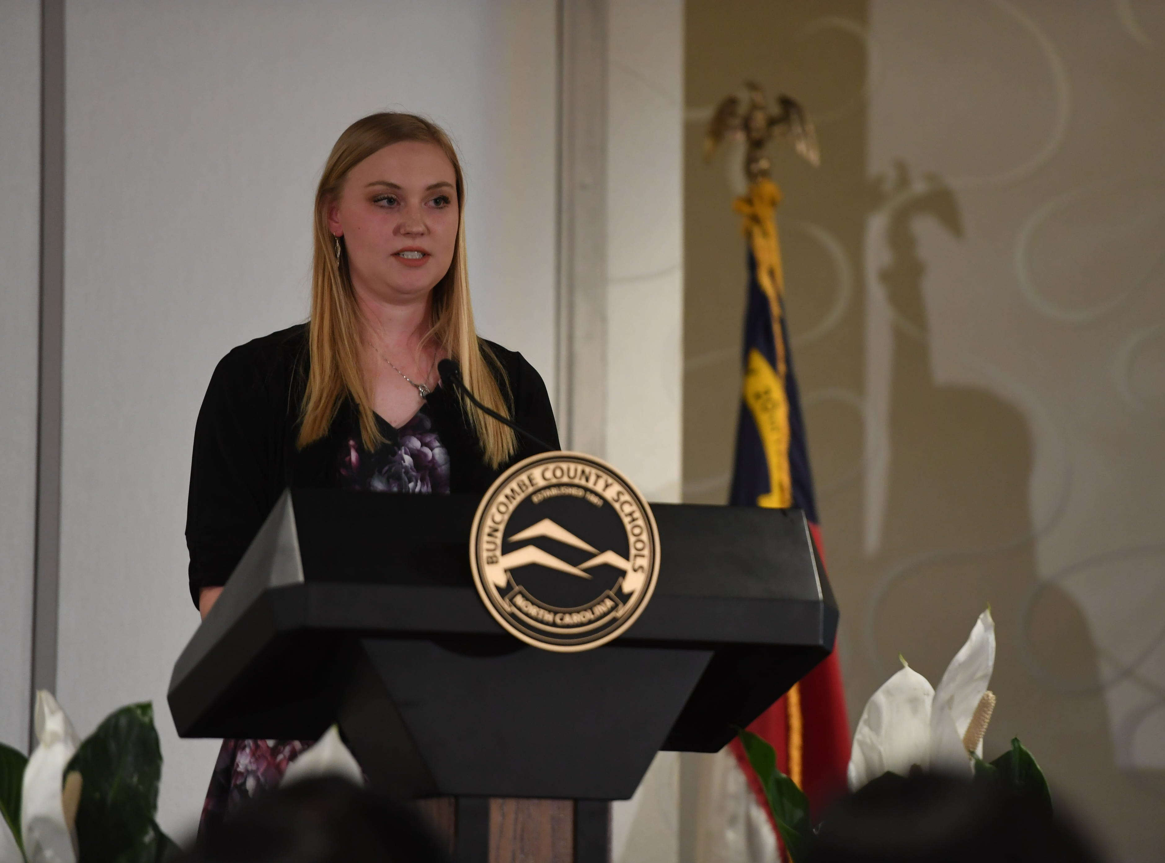 Enka High School senior Neely Bennett speaks during the Buncombe County Top Scholars Banquet April 30, 2019 at the Renaissance Hotel in Asheville.
