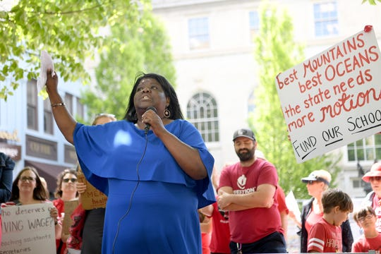 Educator Libby Kyles speaks to the crowd during the Asheville rally for public education at the Vance monument on May 1, 2019. The rally coincided with the NC Association of EducatorsÕ Day of Action in Raleigh.