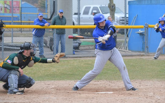 Former Harper Creek graduate AJ Mitchell takes a swing for Kellogg Community College in action earlier this season.