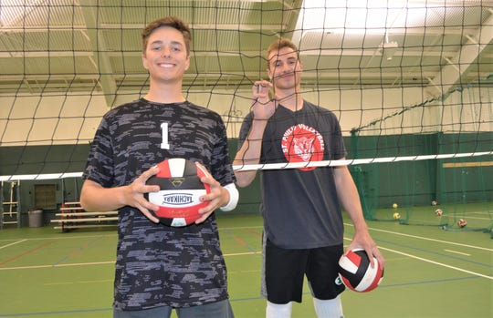 A Battle Creek team, which includes seniors, from left, Sam Mateer of Harper Creek and Sam Krauss of Pennfield, is among a group of 12 squads across the state playing high school boys volleyball in the Michigan Boys Volleyball Conference. The group is hoping in the near future boys volleyball become an official MHSAA sport.
