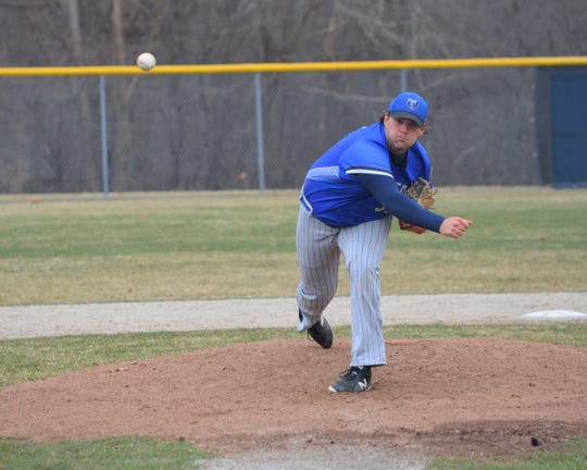 KCC pitcher Jarrod Melle throws home in action earlier this season.