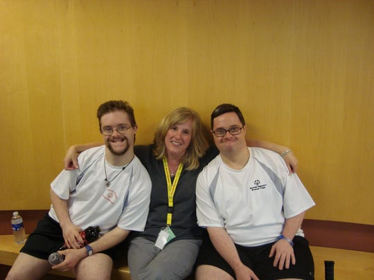 Jenny Sorber (center) has volunteered with Special Olympics since 2005.