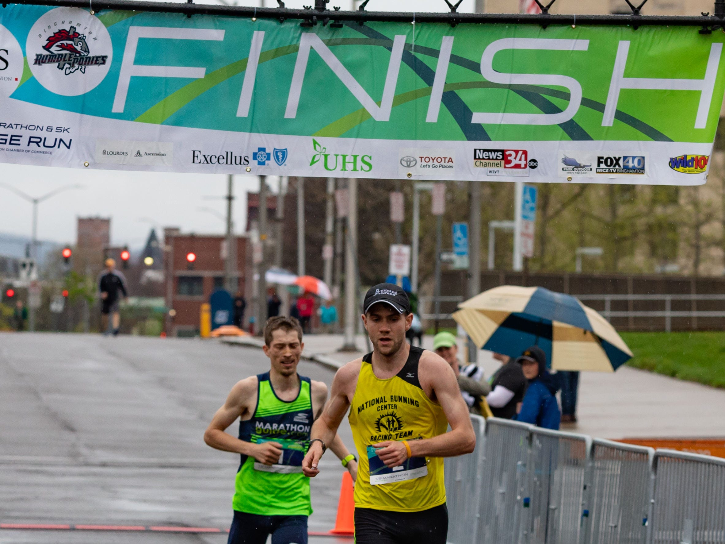 2018: First Place finisher Rob Ahrens edged out Bryan Morseman with a time of 1:10:48 in the Binghamton Bridge Run Half Marathon Sunday Morning