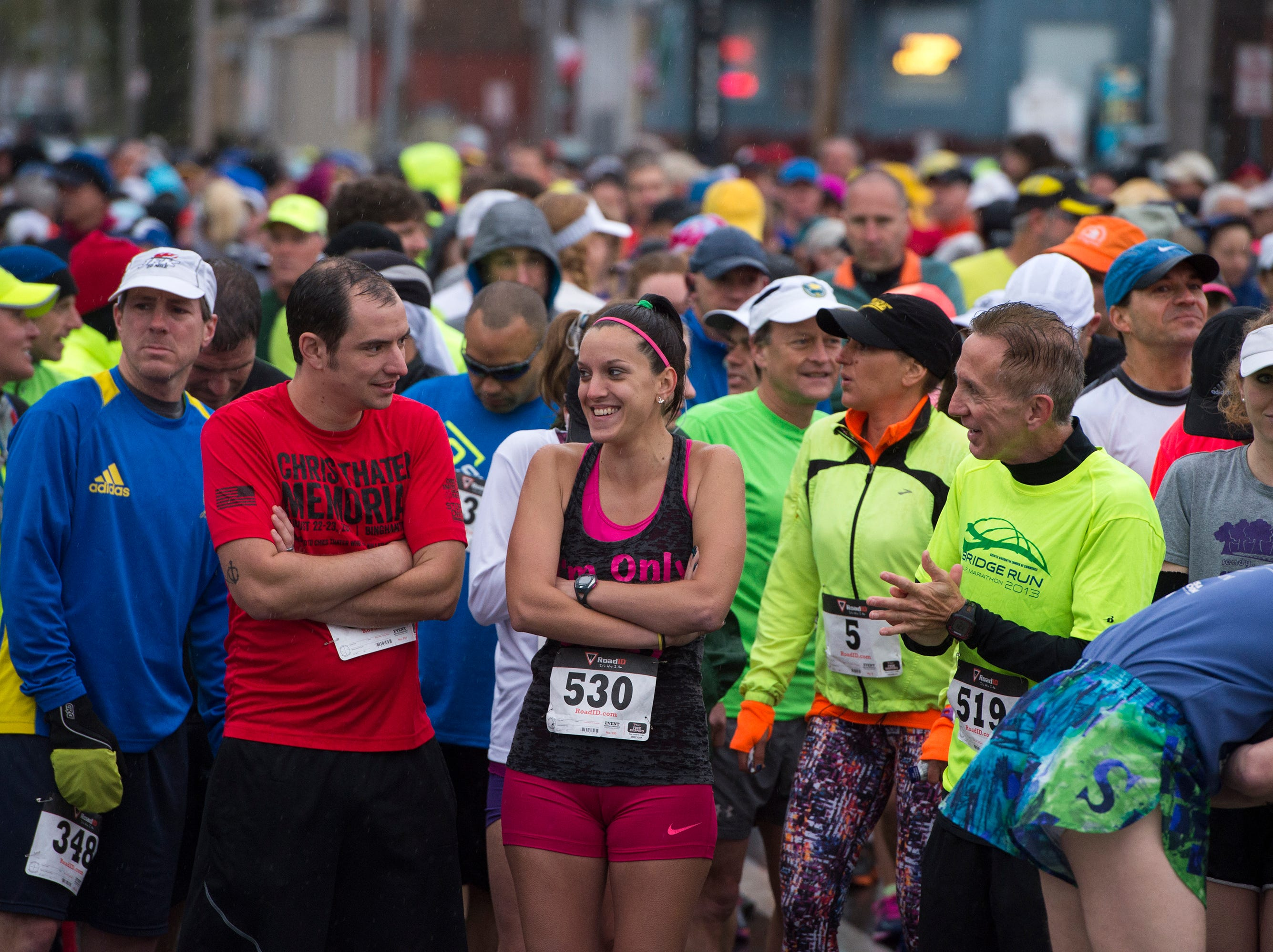 2016: Runners brave the cold while waiting for the start of the Greater Binghamton Bridge Run half marathon on Sunday.