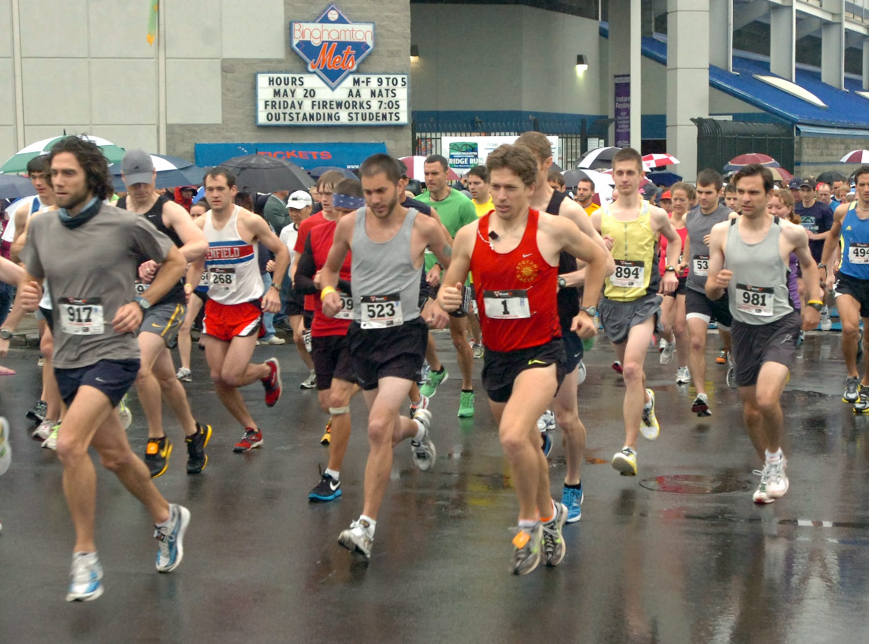 2011: Runners leave from the starting line outside NYSEG Stadium in the Greater Binghamton Bridge Run Half Marathon on Sunday. Roughly 890 runners competed in the inaugural race through the streets and over bridges in downtown Binghamton.
