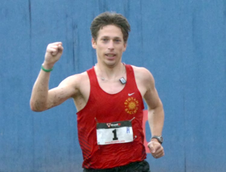 2011: Fred Joslyn, a Chenango Forks graduate, pumps his fist as he nears the finish line of the Greater Binghamton Bridge Run Half Marathon on Sunday. Joslyn won the inaugural race in a time of 1:08:57 on a course through streets and over bridges in downtown Binghamton.