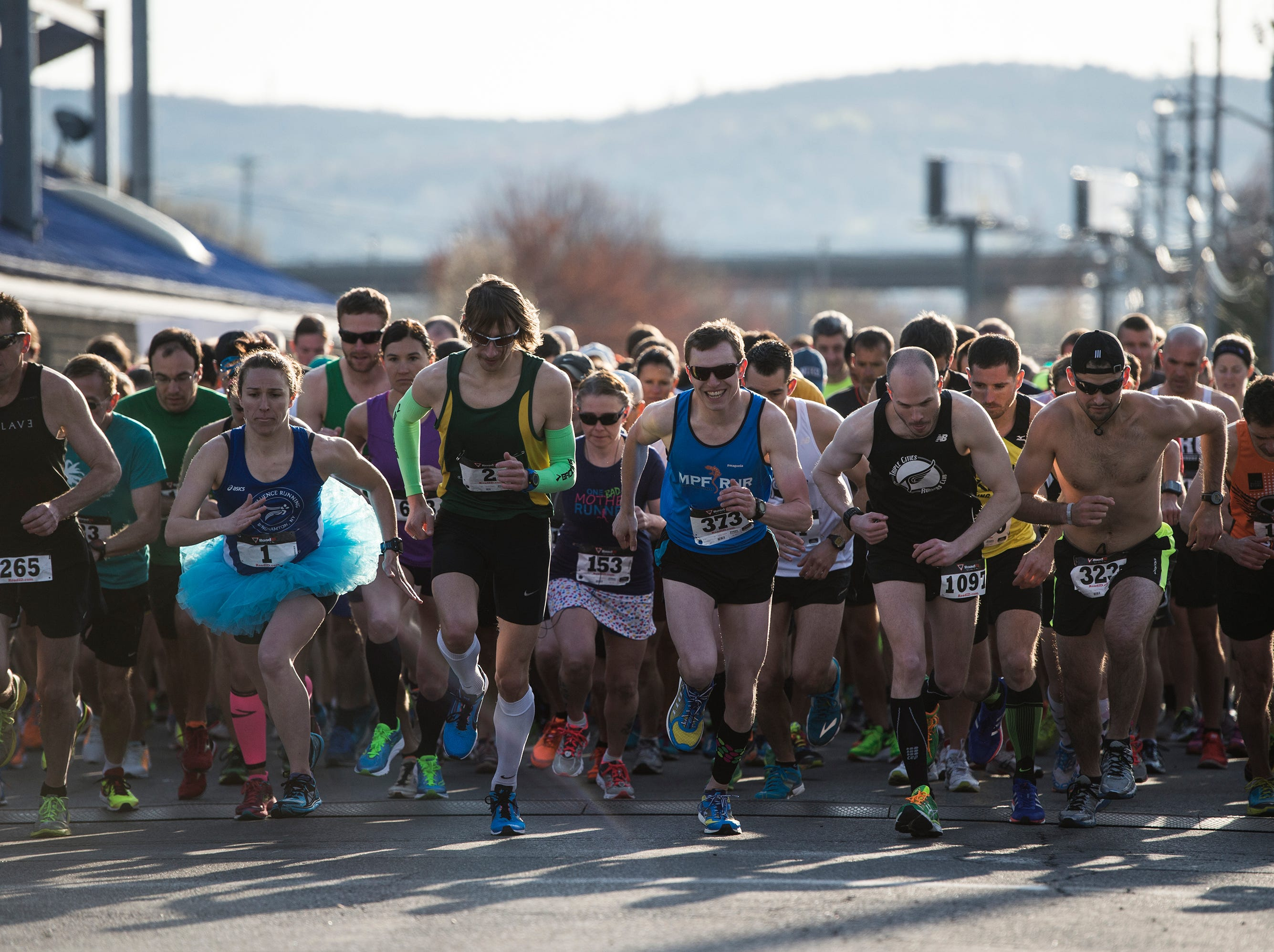 2015: Runners take off at the starting line of the Greater Binghamton Bridge Run 5k on Sunday, May 3, 2015.