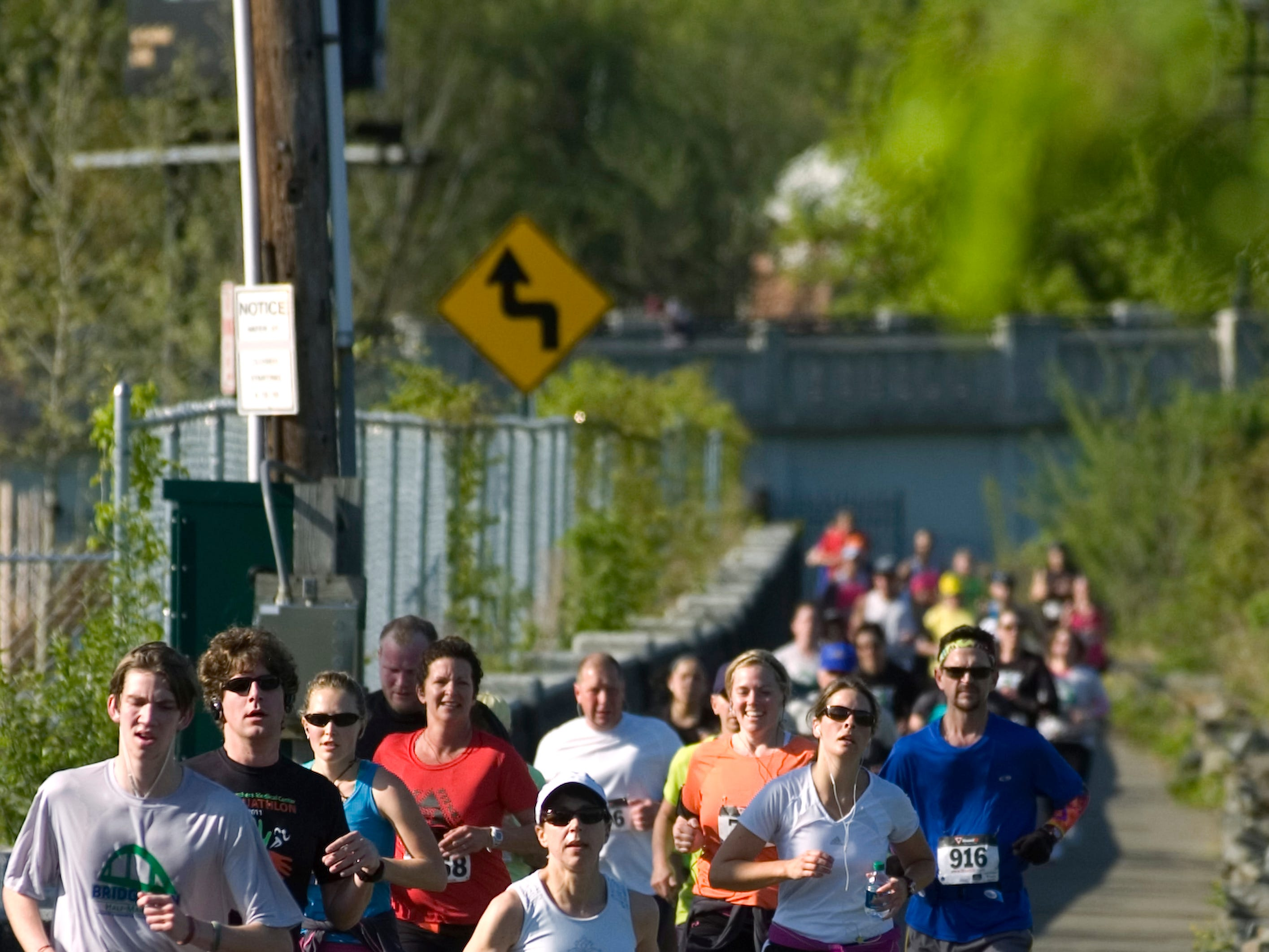 2012: Race participants make their way down the river walk during the Greater Binghamton Chamber of Commerce Bridge Run half-marathon on Sunday morning in downtown Binghamton.