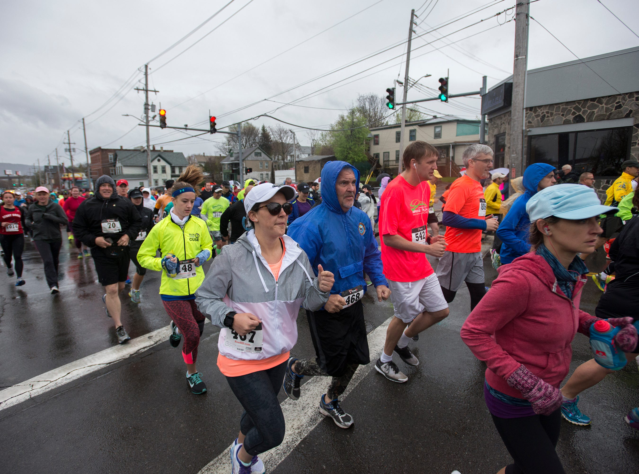 2016: Runners take off at the starting line of the Greater Binghamton Bridge Run half marathon in front of NYSEG Stadium in Binghamton on Sunday, May 1, 2016.
