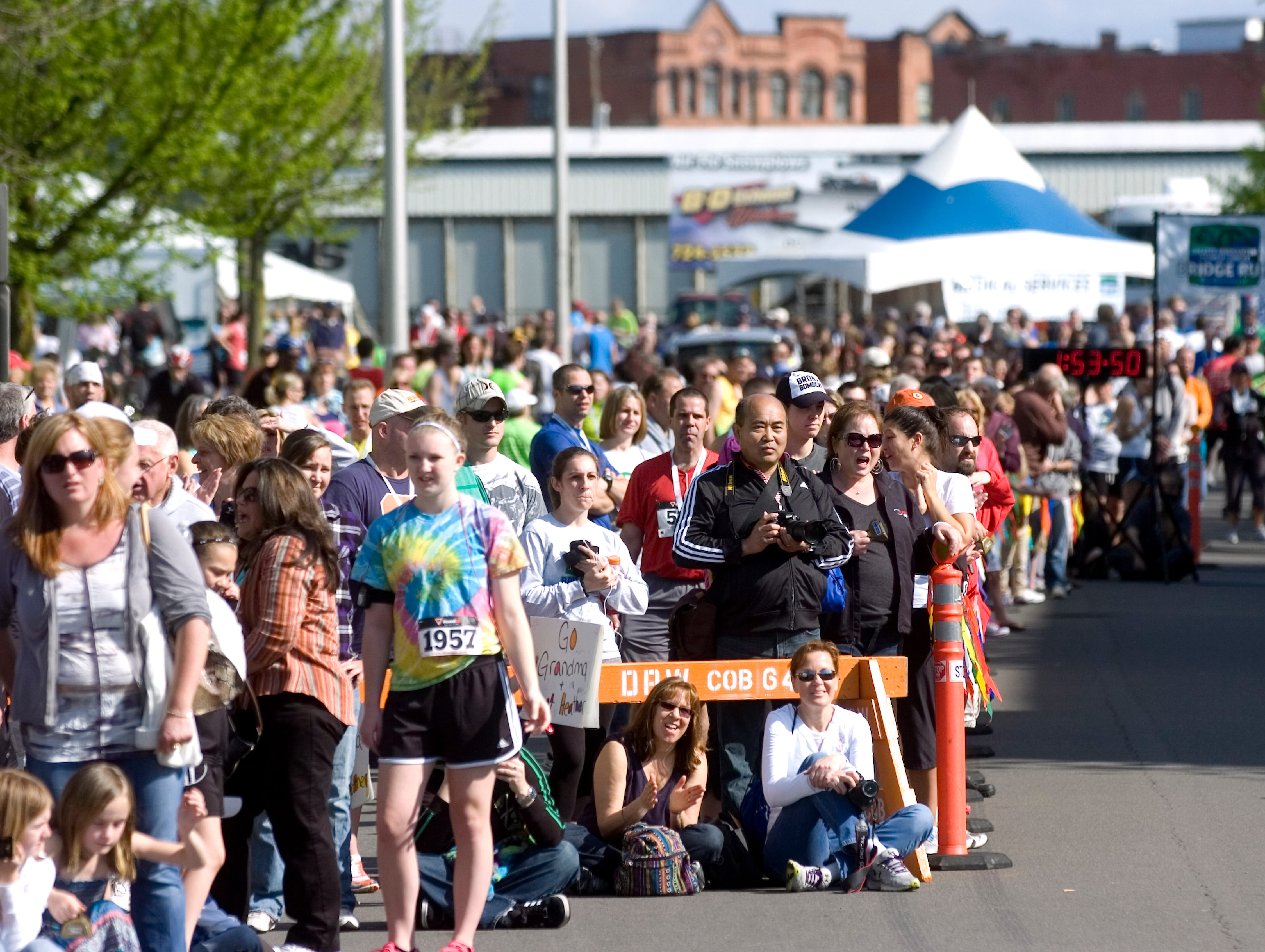 2012: A crowd gathers to watch runners cross the finish line during the Greater Binghamton Chamber of Commerce Bridge Run half-marathon on Sunday in downtown Binghamton.