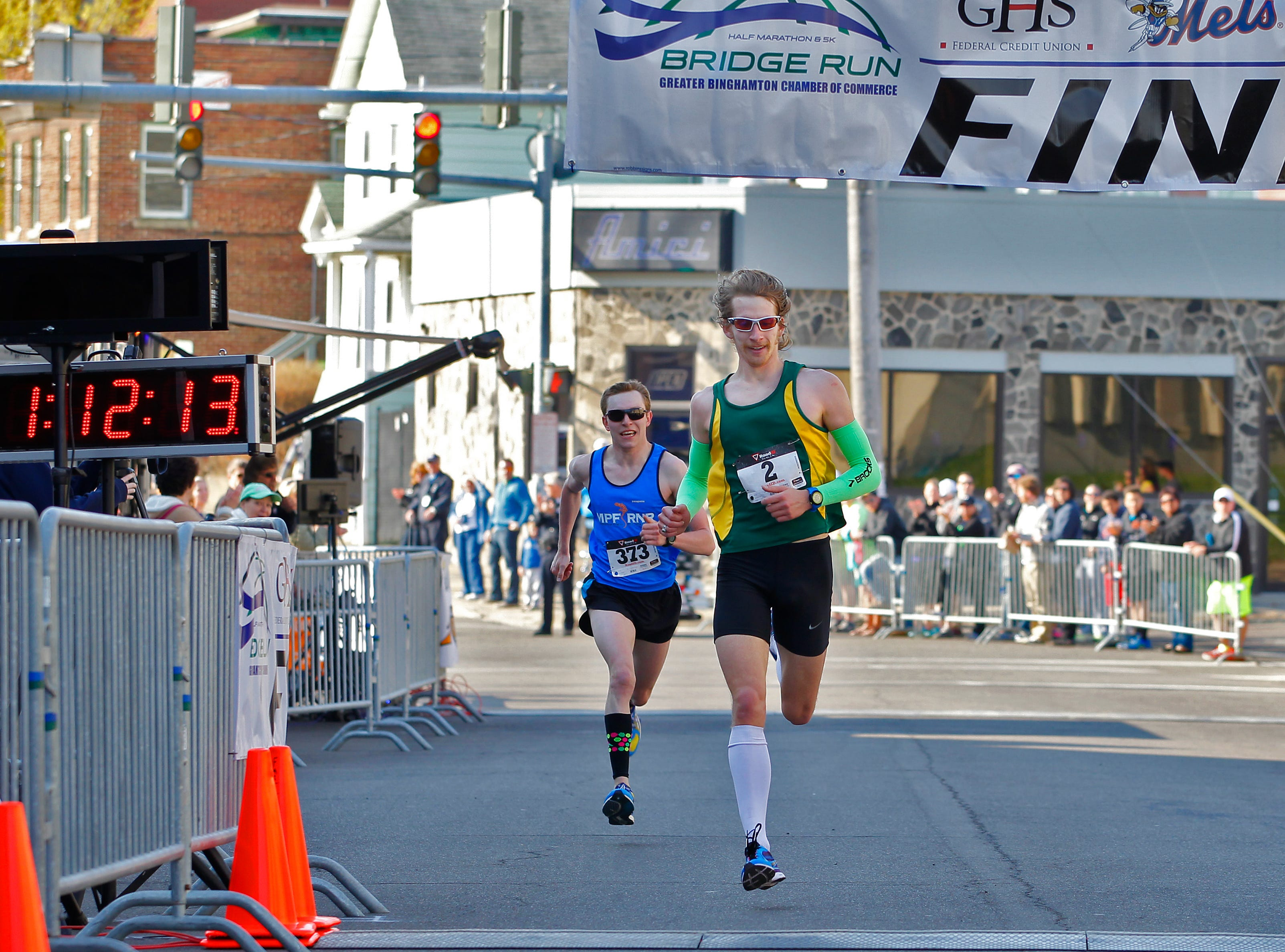 2015: Benjamin Snodgrass, 23, of Apalachin takes first place while Cole Crosby, 26, of Cortland takes second in the half marathon during the Bridge Run on Sunday, May 3.