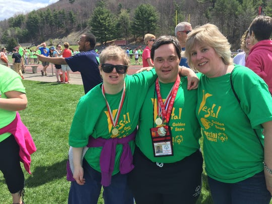 Jenny Sorber (far right) has volunteered locally with Special Olympics since 2005.