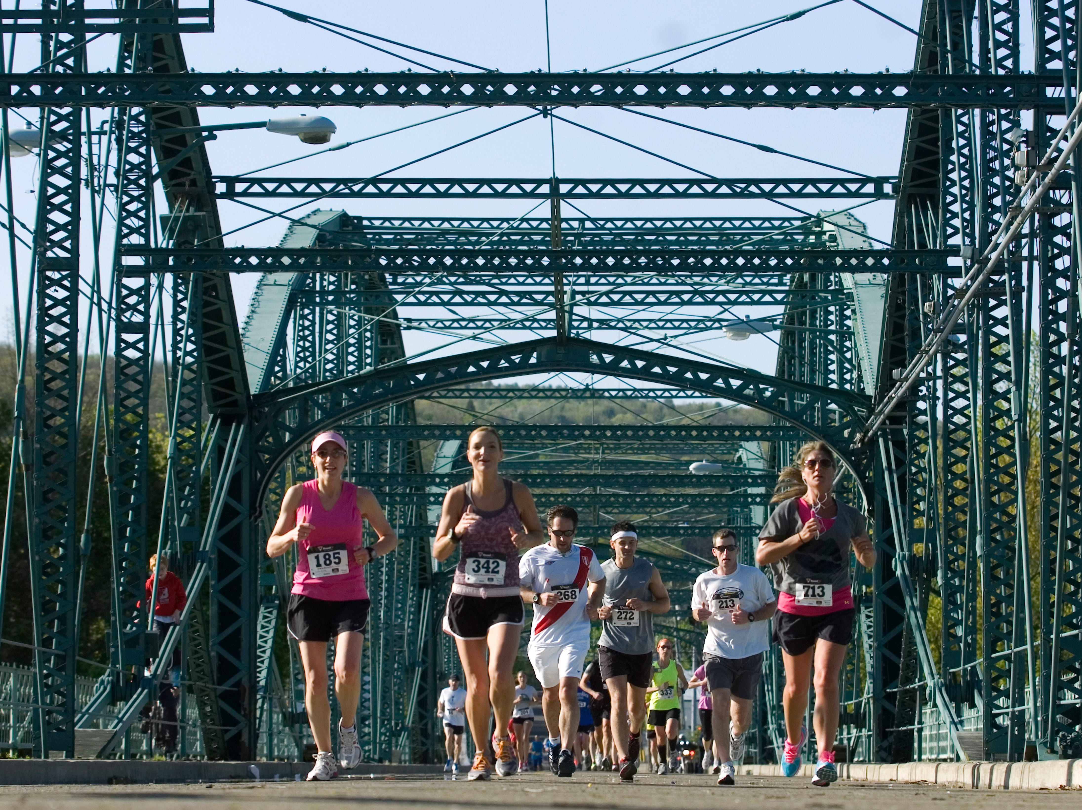 2012: Race participants make their way over the Washington St. bridge during the Greater Binghamton Chamber of Commerce Bridge Run half-marathon on Sunday morning in downtown Binghamton.