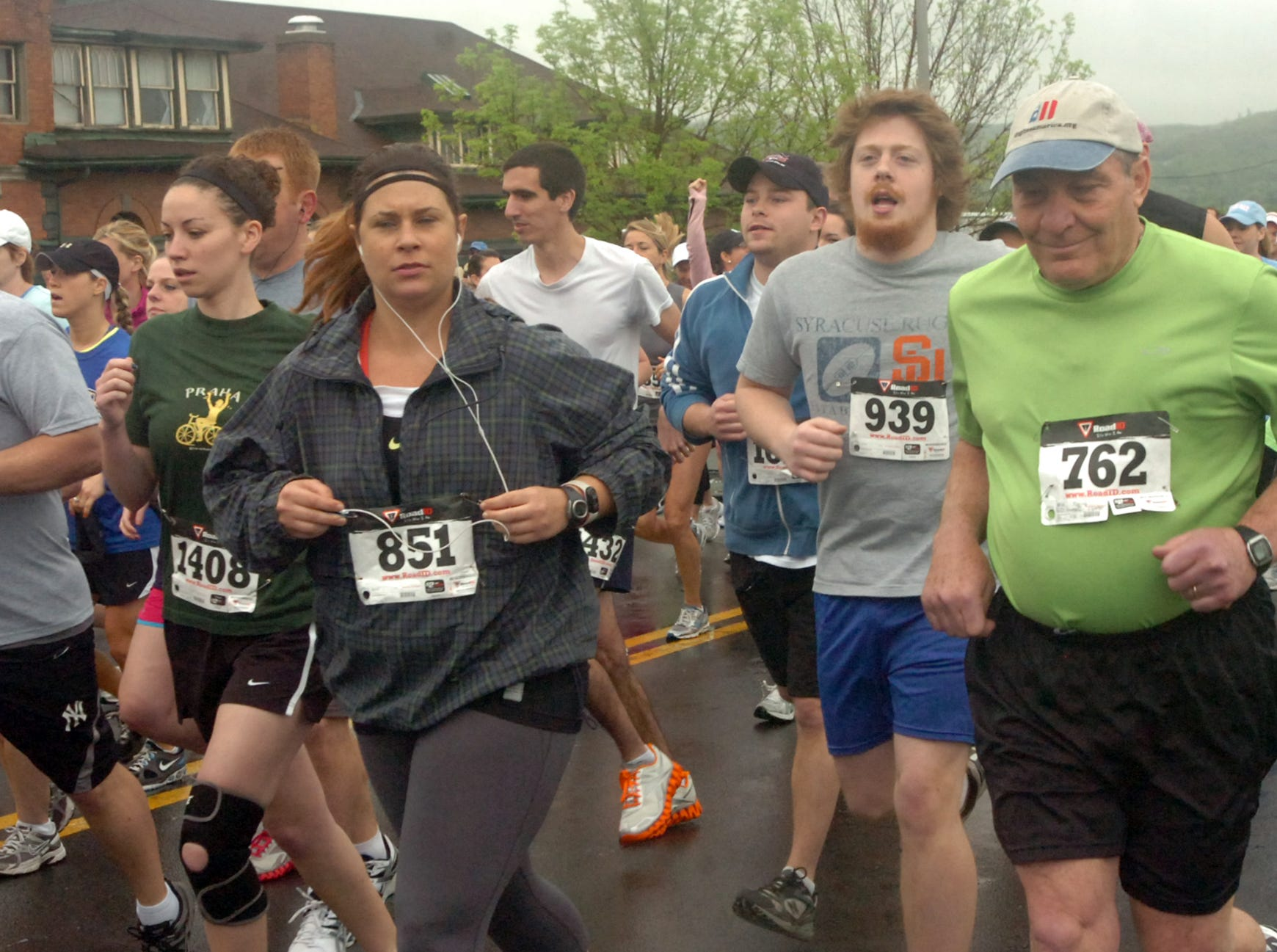 2011: Don Carle, Melissa Tabeek, Laura Link, Logan McAvoy and Douglas Kerr (left to right) leave the starting line on Lewis Street outside NYSEG Stadium for the 5K run in Greater Binghamton Bridge Run on Sunday. Roughly 600 runners ran in the inaugural race on a course through streets and over bridges in downtown Binghamton.