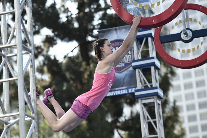 Ella McRitchie swings through the American Ninja Warrior Junior course.