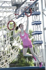 Ella McRitchie swings through the American Ninja Warrior Junior course.