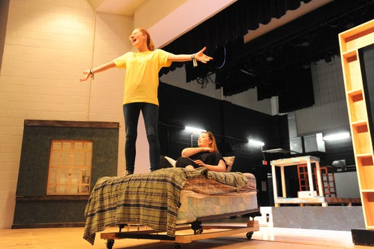 "Ava Miller belts out a tune during rehearsals for ""She Loves Me,"" the annual spring production by the Owen High School performing arts students."