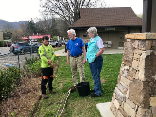 Arborist Scott Abla advises Bill and Roi McGuire on how to best care for the Southern Crabapple they received for Arbor Day.