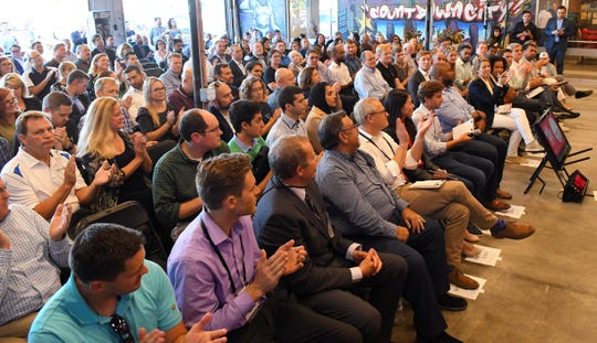 The crowd claps during Tuesday's Rise of the Rest $100,000 pitch competition at Groundswell Startups in Melbourne.