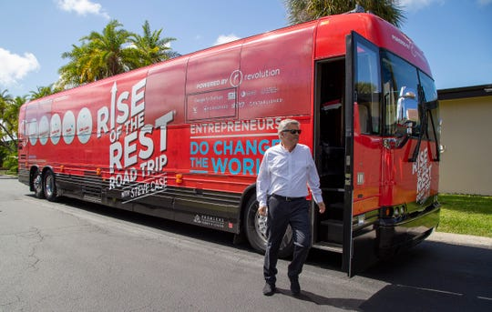 AOL co-founder Steve Case steps off his Rise of the Rest tour bus Tuesday at the Florida Institute of Technology