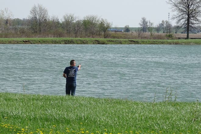 Recent retiree Jack Agler takes advantage of the sunny day Wednesday to do some fishing at Crossroads Pond. On Saturday, the pond will be the site of the Bucyrus Rotary Club's annual Fishing Derby.