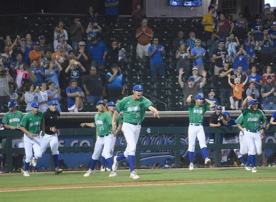 The Texas A&M-Corpus Christi baseball team celebrates winning the game against Texas, Tuesday, April 30, 2019, at Whataburger Field. The Islanders won, 8-2.