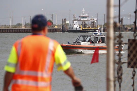 A police dive team and Coast Guard officials search the ferry landing in Aransas Pass. Authorities say a truck drove off the landing during a police chase Tuesday night.