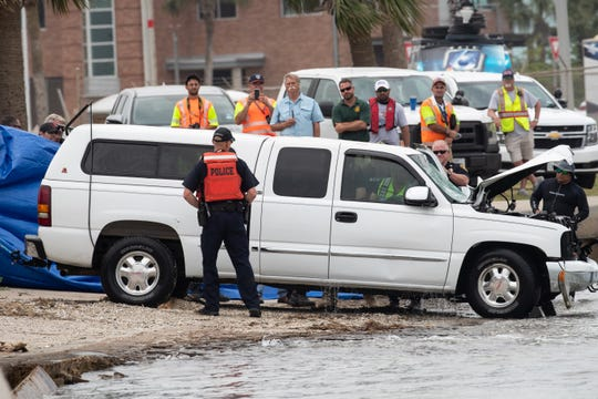 The Port Aransas police remove the body of the driver after a car was pulled form the shipping channel in Port Aransas near the ferry landing following a crash on Wednesday, May 1, 2019. The car went in to the shipping channel during a police chase Tuesday evening.