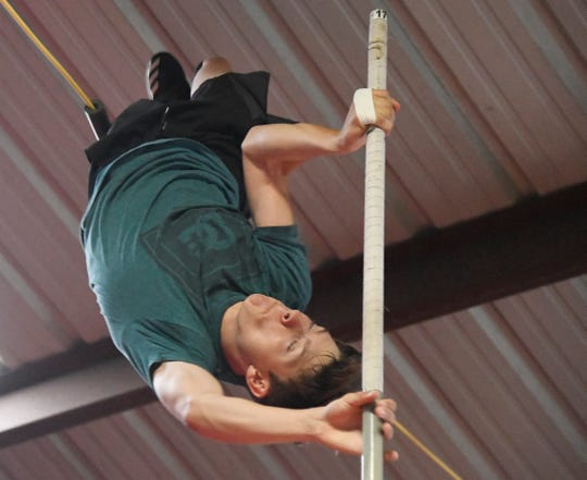Anthony Meacham pole vaults during practice,Tuesday, April 30, 2019 in Woodsboro. Meacham won the boys vault with a regional meet record vault of 16-feet, 1 inch, Friday, April 26, 2019.