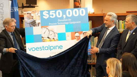 Stefan Einfalt, CEO Voestalpine Texas, (second from right) helps unveil the company's donation to Gregory-Portland High School on May 1, 2019.