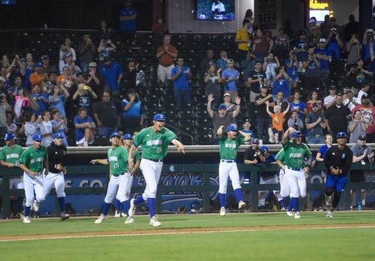 Texas A&M-Corpus Christi Islanders baseball players celebrate against the Texas Longhorns during their game at Whataburger Field on Tuesday, April 30, 2019.