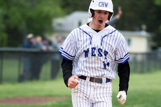 West's Tyler Kubrak (14) cheers as he scores against Shawnee Wednesday, May 1, 2019 in Cherry Hill, N.J. West won 6-2.