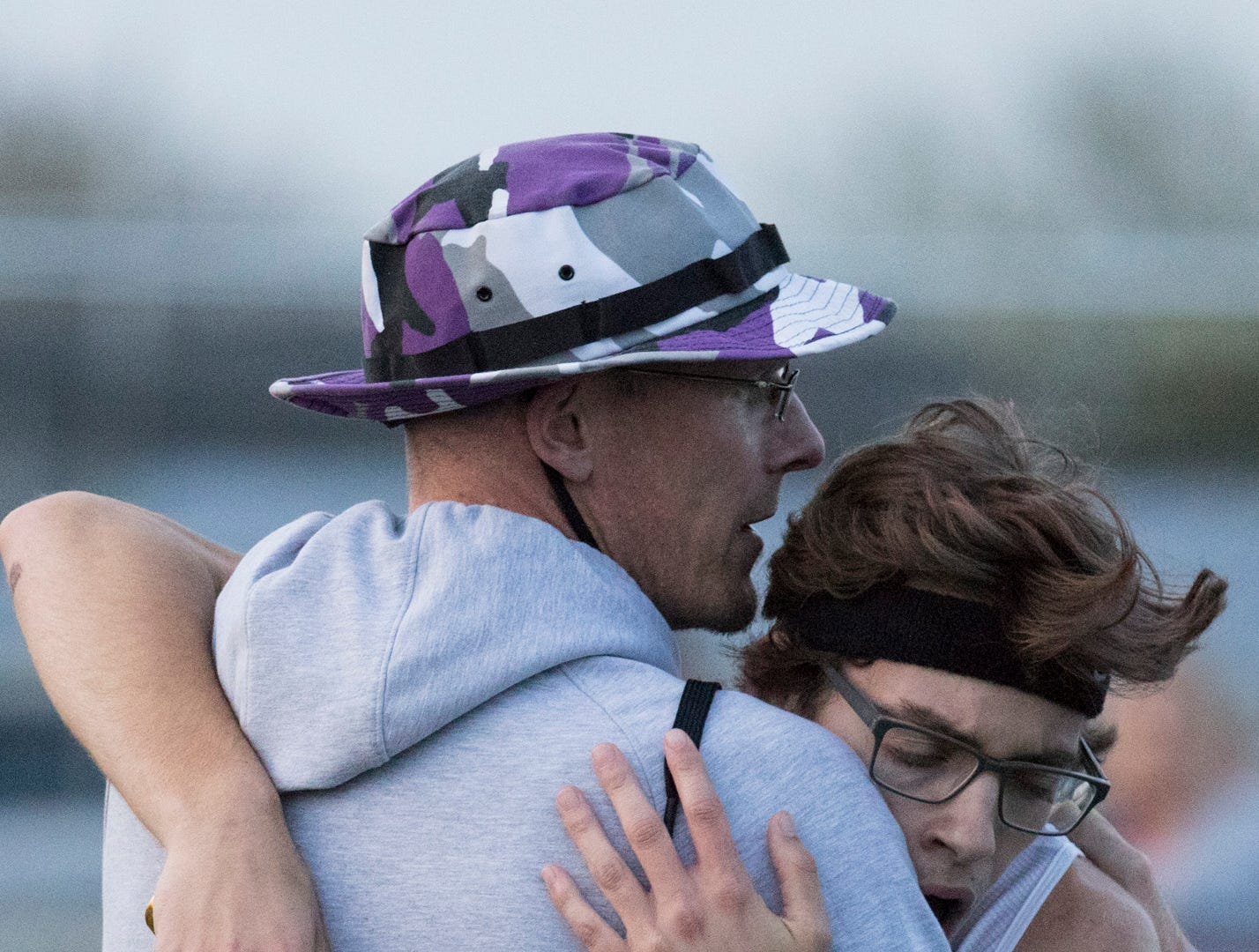Unioto Head Coach Matt Paxton supports runner Robert Immell after Immell almost collapses from exhaustion after completing the last leg of the boys 4x400 meter relay Tuesday night in Frankfort, Ohio, on April 30, 2019. The Unioto boys won the relay with a time of 3:45.70 during the 95th annual Ross County Meet.