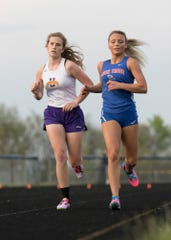 Zane Trace's Reese Hartsaugh and Unioto's Indy Spetnagel fight for first place in the girls 3200-meter run Tuesday afternoon at the 95th annual Ross County Meet in Frankfort, Ohio, on April 30, 2019. Hartsaugh defeated Spetnagel with a time of 13:03.80.