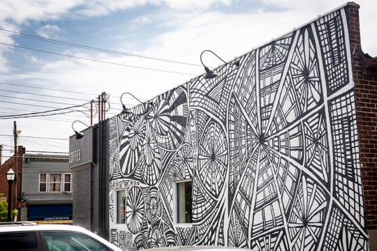 "The ""Expression Explosion"" mural was designed by Michael Bartels and is located at 3056 Madison Road in Oakley. ArtWorks partnered with Visionaries + Voices (V+V) to create this mural."