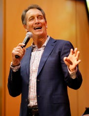 Former Bengals wide receiver Cris Collinsworth tells an old story about Anthony Munoz during the Legends Past and Present event benefitting the Andy and JJ Dalton Foundation and Ken Anderson Alliance at Paul Brown Stadium in downtown Cincinnati on Tuesday, April 30, 2019.