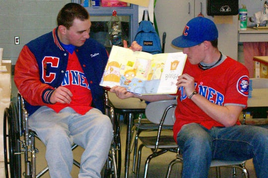 Varsity baseball players from Conner High School, Dallas Willoughby, left, and Drew Hart, right, were guest readers to kindergarten students at Chester Goodridge Elementary School in 2011,