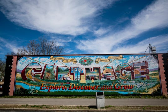 """A Postcard from Home"" mural is located at 7117 Vine Street in Carthage."