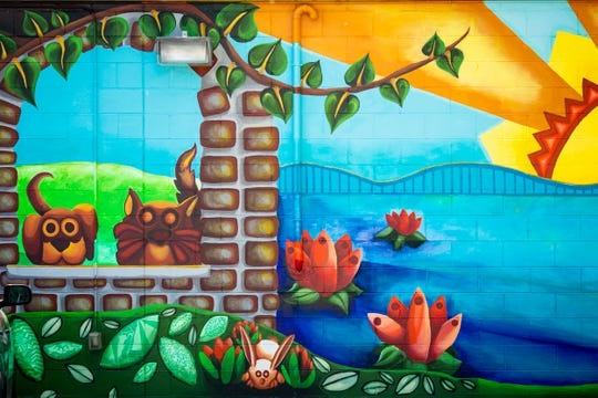 """The """"Along the Hill"""" mural is located at 4518 West Eighth Street on the side of the Covedale Pet Hospital. The mural transitions from the pre-historic era with fossils to the development of West Price Hill. ArtWorks partnered with the Price Hill Will to create this mural."""