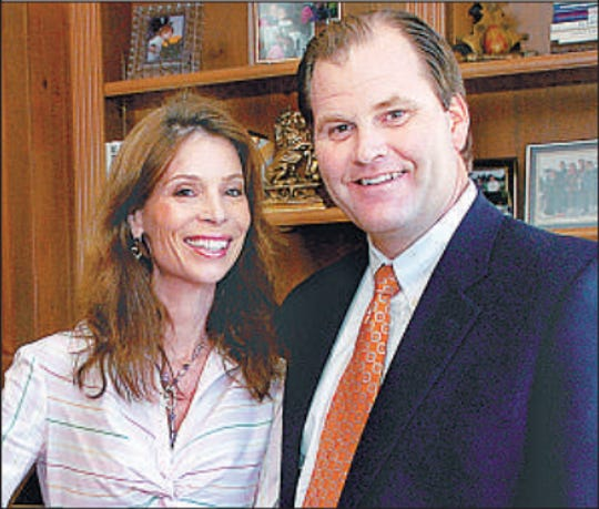 In this photo from 2006, Margie and Mark Hauser of Indian Hill prepare to host President Bush at their Indian Hill home during a fundraiser.