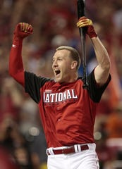 Todd Frazier celebrates after winning the Home Run Derby at Great American Ballpark in downtown Cincinnati on Monday, July 13, 2015.