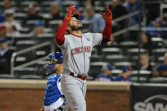 Cincinnati Reds third baseman Eugenio Suarez (7) reacts after hitting a solo home run against the New York Mets during the sixth inning at Citi Field.