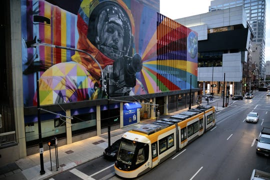 The newly finished mural by by Brazilian muralist Eduardo Kobra overlooks Walnut Street near Fountain Square in downtown Cincinnati on Wednesday, Aug. 31, 2016. The 7,632 square foot mural was funded by Fifth Third Bank and is the largest ArtWorks mural to be installed in Cincinnati.
