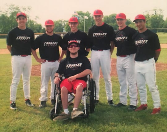 Dallas Willoughby with past Conner baseball players.