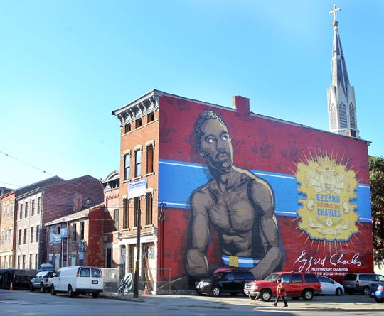The life of boxing legend Ezzard Charles is celebrated with an ArtWorks mural located on the north face of a building at 1537 Republic St., Over the Rhine. Although he was known as The Cincinnati Cobra, Charles was born in Lawrenceville; GA.,  in 1921. He won the National Boxing Association's World Heavyweight title in 1949,  outpointing Jersey Joe Walcott. He successfully defended the title against Joe Louis. Charles fought as a Middleweight, Light Heavyweight and Heavyweight during his career.  Charles nearly gave up boxing in 1948 after he knocked out Sam Baroudi,  who died five hours after the fight of a brain hemmorrhage. Charles was diagnosed in 1968 with ALS (amyotrophic lateral sclerosis, Lou Gehrig's disease ) in 1968 and died in a Chicago nursing home in 1975.