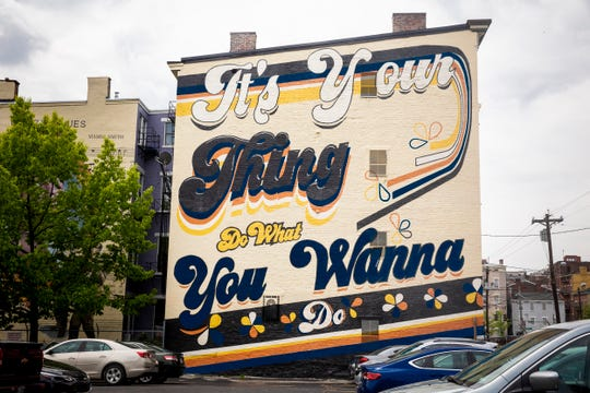 """The """"ItÕs Your Thing"""" mural was designed by Jonathan and Lindsey Lamb of LK MNDD and is located at 311 East 13th Street in Pendleton. The mural celebrates the work of Cincinnati-born musical legends the Isley Brothers. ArtWorks partnered with Bartlett Wealth Management to create this mural."""