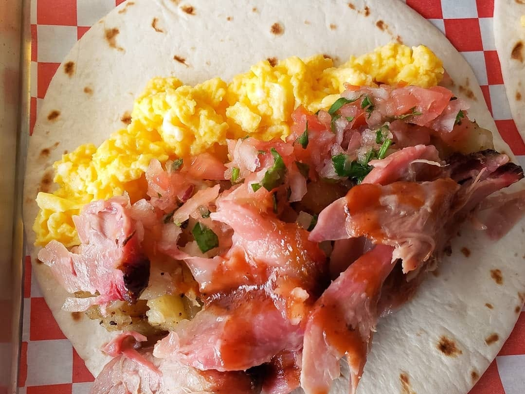 The breakfast taco featuring smoked meat from the Legends Smokehouse & Grill food truck.