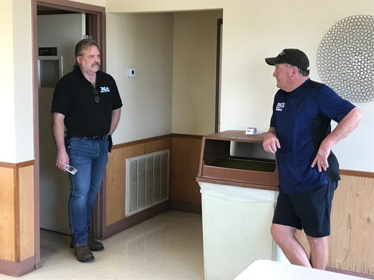 Jeff Plank, left, and Ricky Jennette discuss their plans for reopening the Clarksville franchise of Whitt's Barbecue after its owners were killed in a wreck in March.